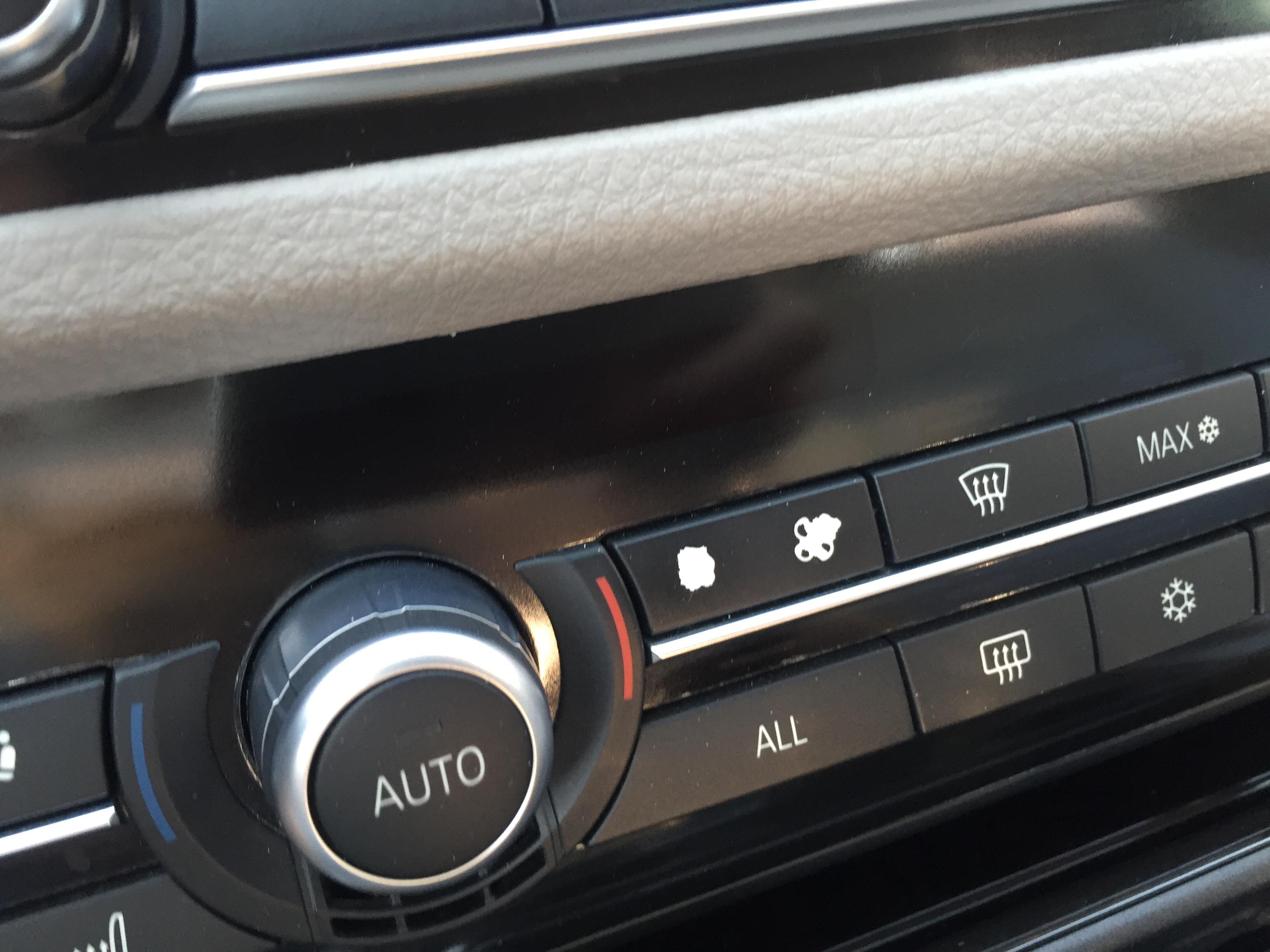 宝马5系空调按键磨花了